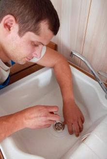 Brentwood plumbing contractor removes a sink drain stopper